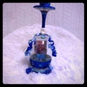 Personalized blue candle holder with photo.